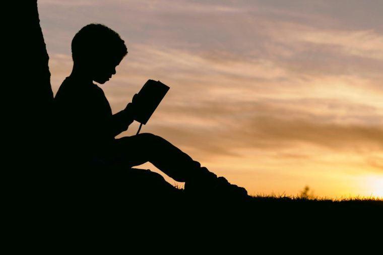negative-space-silhouette-child-reading-sunset-aaron-burden-thumb-1